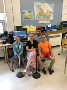 Image of Mr. Palmer and three students involved in the Studio 56 Podcast.